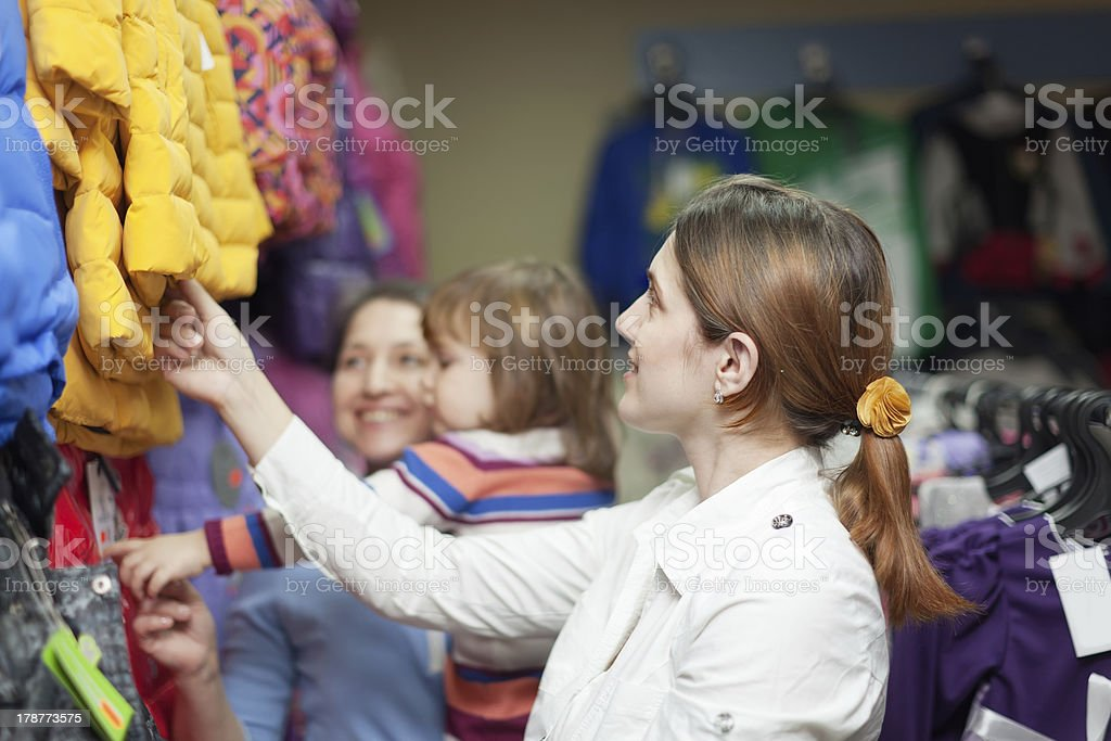 family at  clothes store royalty-free stock photo