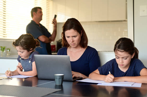 Family at home as the pandemic coronavirus (COVID-19) forces many employees and students to work and study from home stock photo
