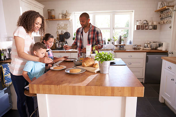 Family At Home Eating Breakfast In Kitchen Together – Foto