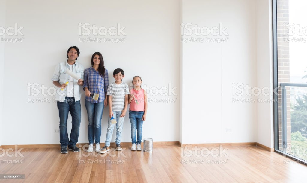 Family At Home Painting Their House Royalty Free Stock Photo