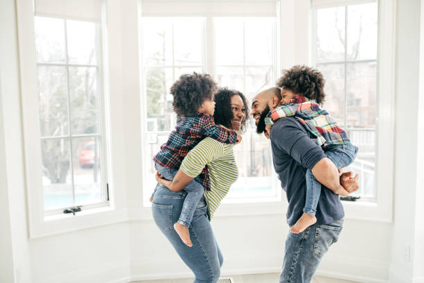 Family at home with two kids stock photo