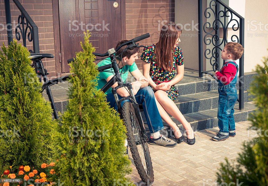 family at house porch stock photo