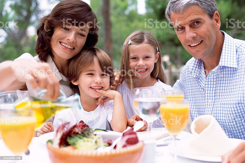 Family at lunch outdoors royalty-free stock photo