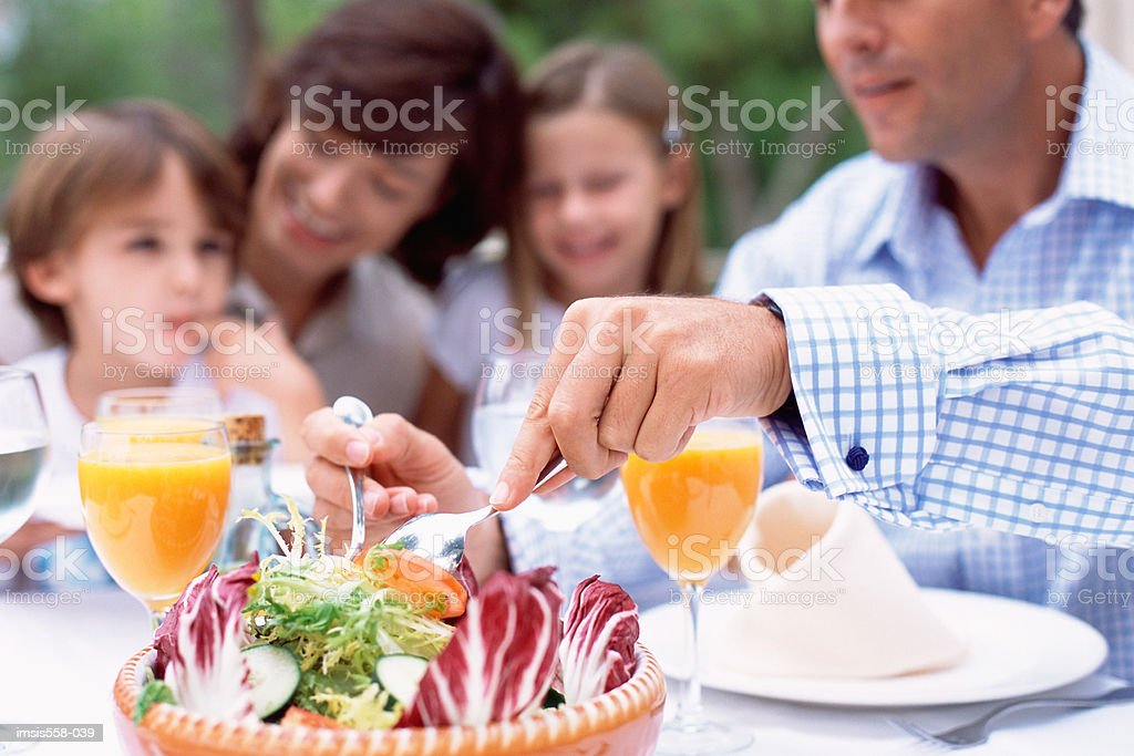Family at lunch outdoors royalty-free 스톡 사진