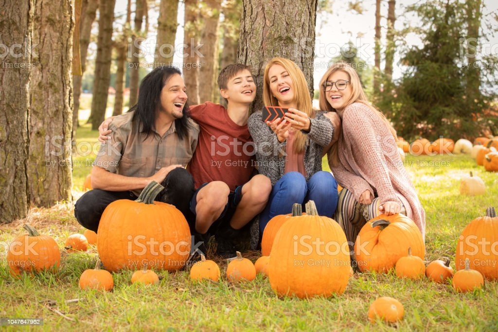 Family at Pumpkin Farm Laughing at Selfie on Cell Phone - Royalty-free 14-15 Years Stock Photo