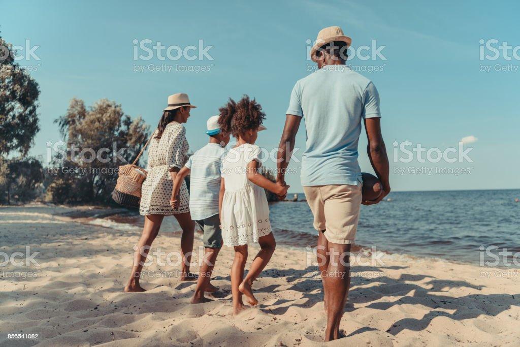 family at seaside stock photo