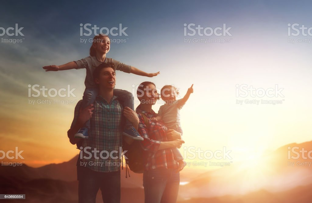 family at sunset stock photo