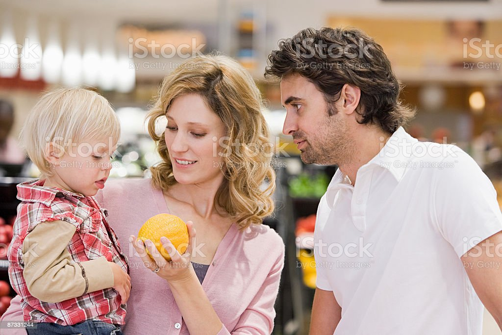 Family at supermarket royalty-free stock photo