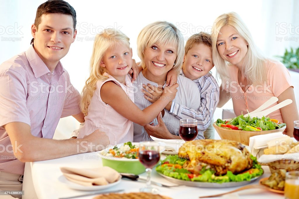 Family at Thanksgiving dinner royalty-free stock photo