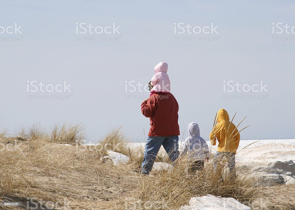 Family At the Beach in Winter: Father and Children royalty-free stock photo