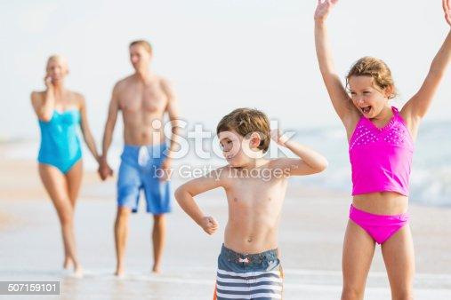 istock Family at the beach 507159101