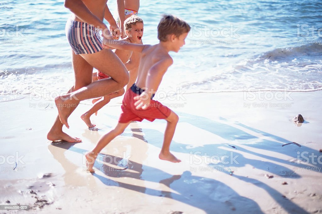 Family at the beach royalty-free stock photo