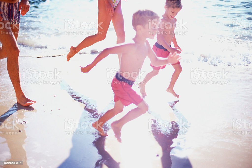 Family at the beach 免版稅 stock photo