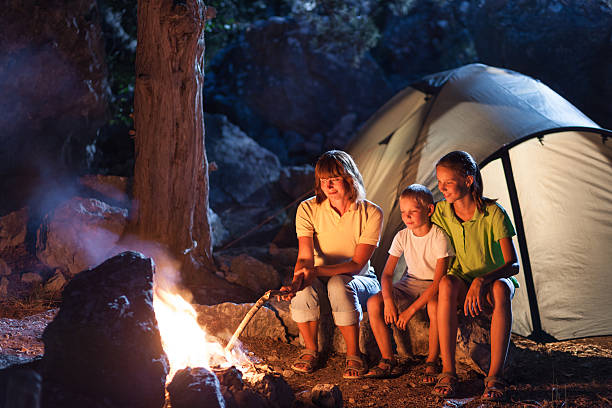 Family at the camping at night stock photo