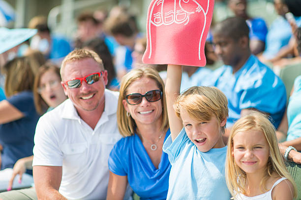 family at the game - sports event stock photos and pictures