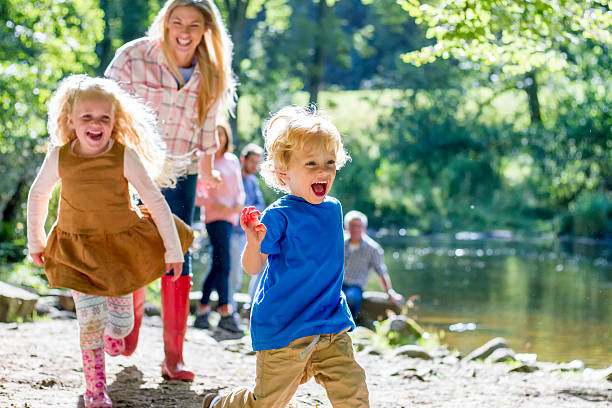 family at the lake - rural lifestyle stock photos and pictures