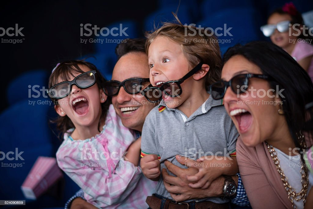 Family at the movie theatre stock photo