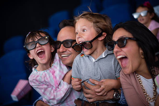 Family at the movie theatre Family at the movie theatre enjoying a 4D experience 3 d glasses stock pictures, royalty-free photos & images