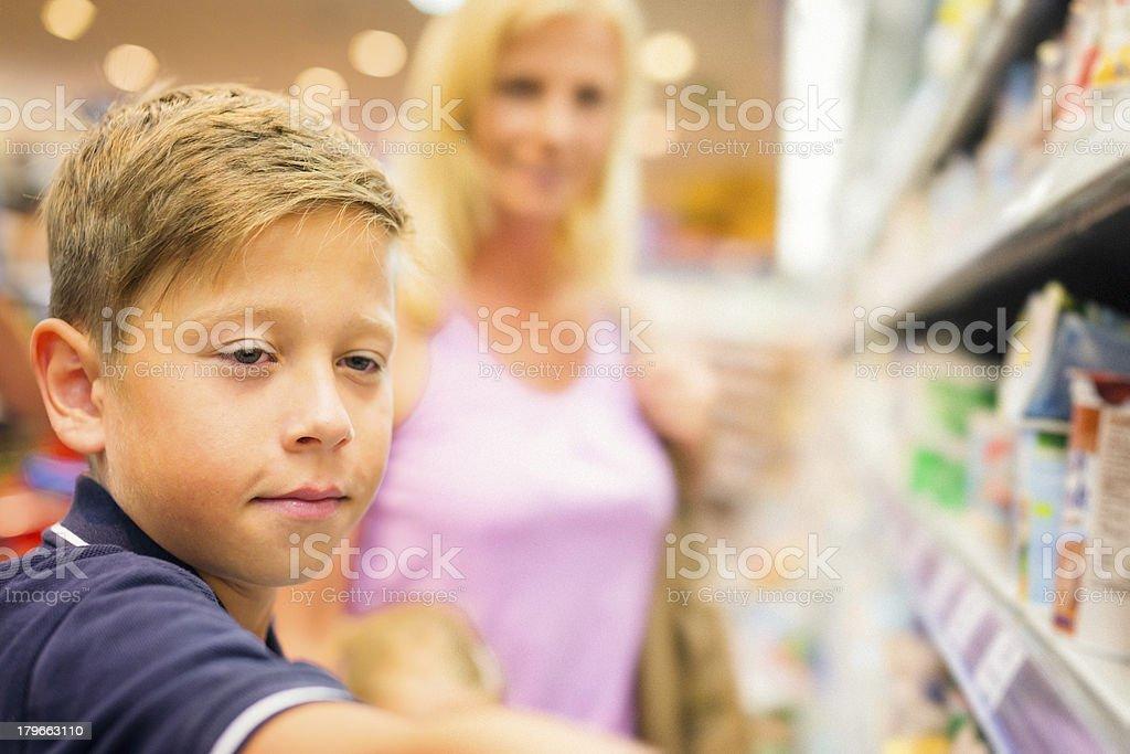 family at the supermarket royalty-free stock photo