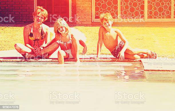 Family at the swimming pool picture id929047076?b=1&k=6&m=929047076&s=612x612&h=c99qs8euksdrla4hwep5jgahajzv3y1hppdbxex58vw=