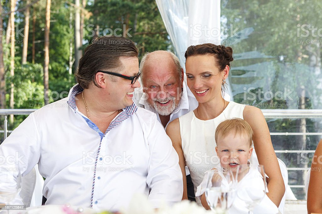 Family at the wedding table royalty-free stock photo