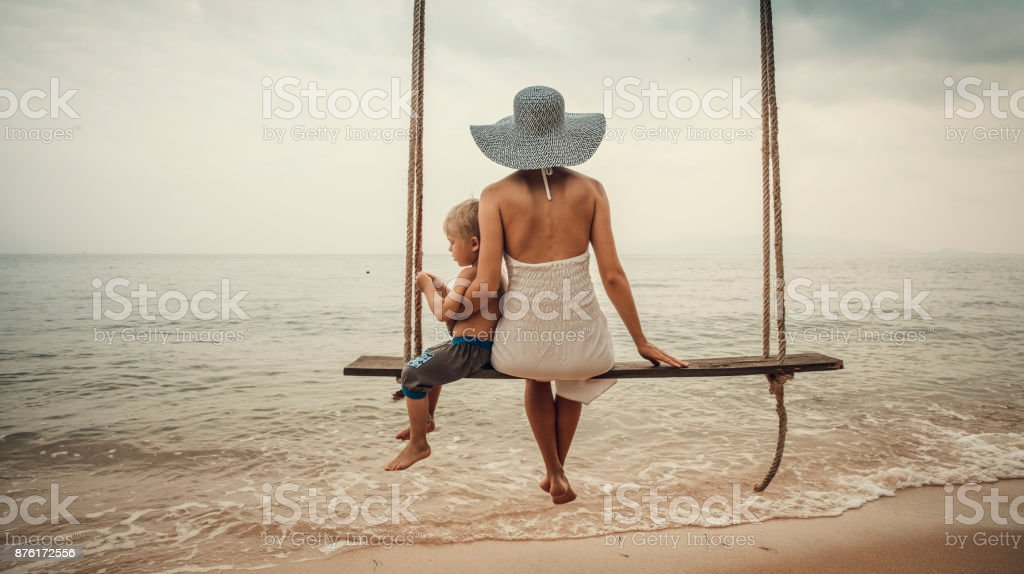 Family at tropical swing stock photo