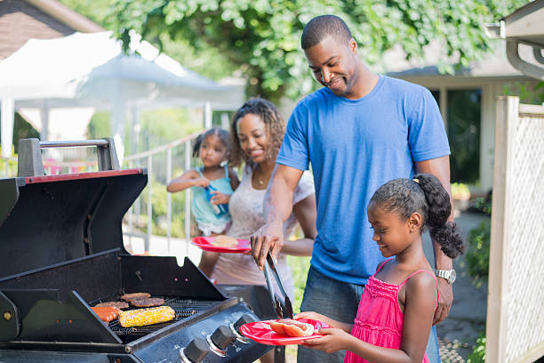 family barbecue on father's day - grilled stock photos and pictures