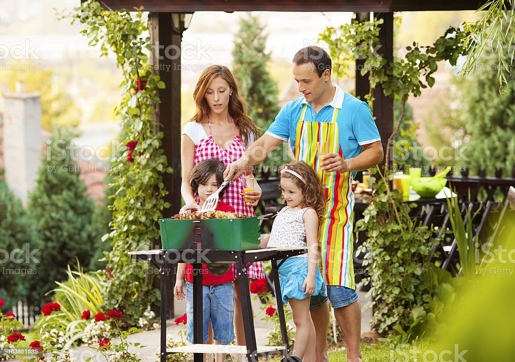 Family Barbecue Outdoors. royalty-free stock photo