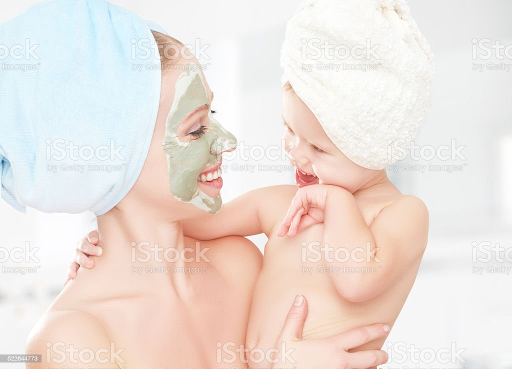 family beauty treatment, mother and daughter make mask for skin stock photo