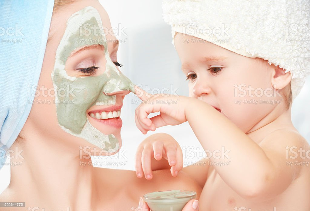 family beauty treatment mother and daughter make mask for skin stock photo
