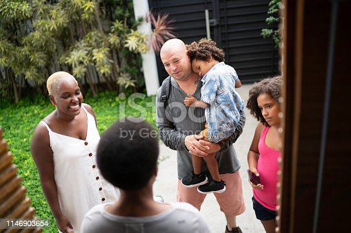 Family being welcome to rental house during vacation