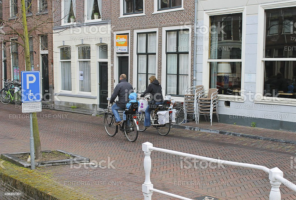 Family bike rides on the morning of  city. Delft. Netherlands royalty-free stock photo