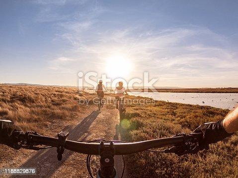 Multi-ethnic family mounting biking in public park: Shoreline at Mountain View, California, USA
