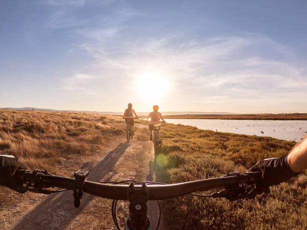 POV of Family Biking Along Shoreline Trail, California, USA stock photo