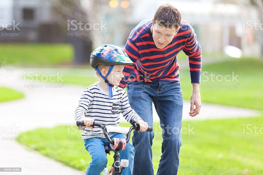 family biking stock photo