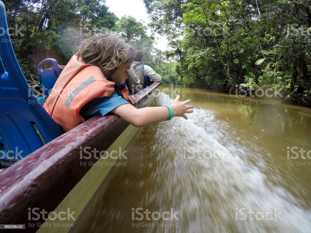 Family braves the Amazon Jungle in a boat