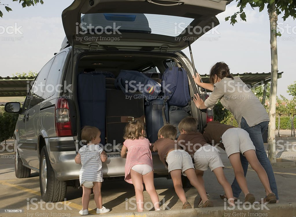 Family break down - Pushing their very loaded van stock photo