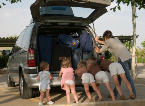 Family Break Down Pushing Their Very Loaded Van Stock Photo - Download Image Now