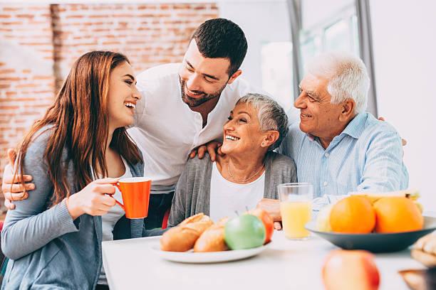 family breakfast - yalnızca yetişkinler stok fotoğraflar ve resimler