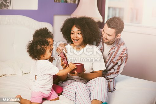 istock Family bringing mother presents in bed 861059958