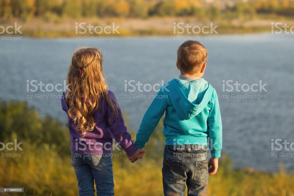 Family. Brother and sister by the river stock photo