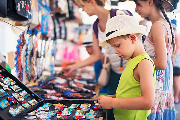 Family browsing souvenirs at the majorcan street market stand stock photo