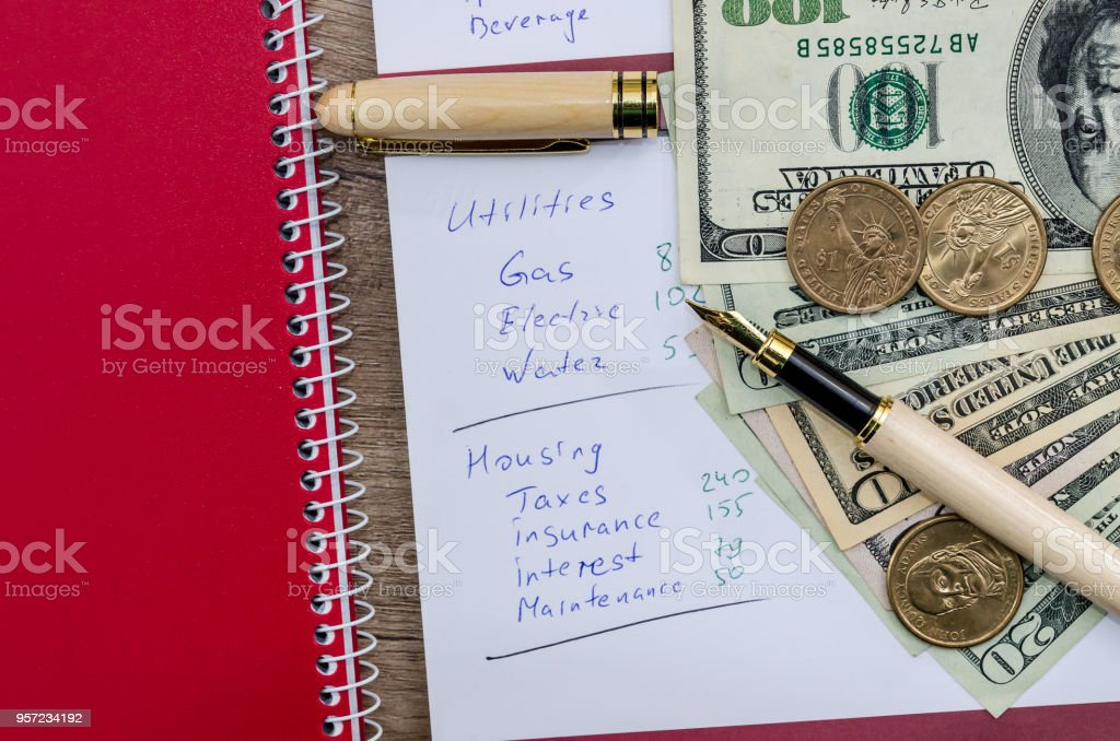 Family budget planning, dollar with pen and notepad stock photo