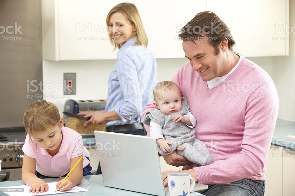 Family busy together in kitchen royalty-free stock photo