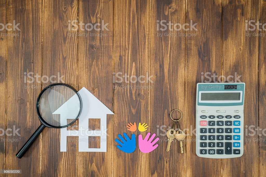 family buy house Mortgage calculations, calculator with Magnifie stock photo