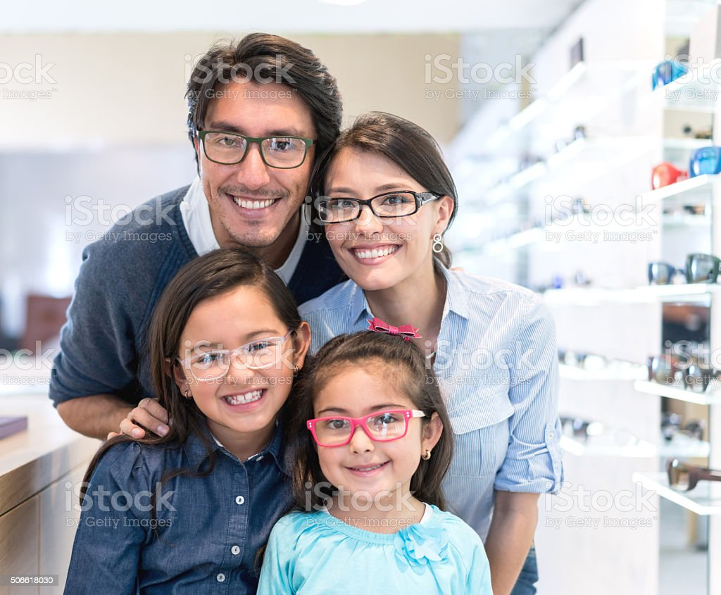 Family buying glasses at the optician's shop stock photo