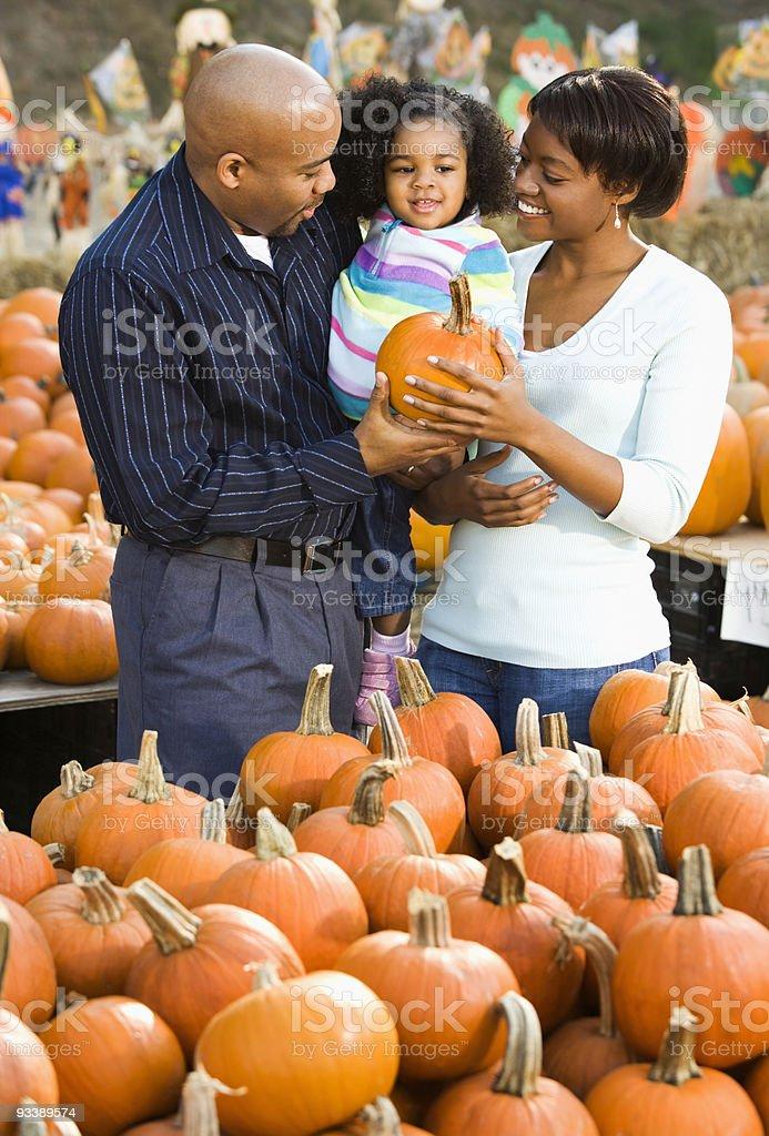 Family buying pumpkin. royalty-free stock photo