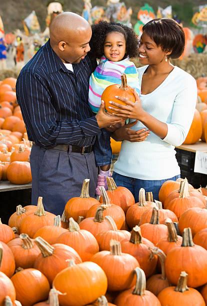 Family buying pumpkin. stock photo