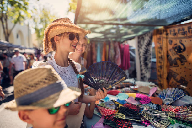 Family buying souvenirs on flea market in Andalusia, Spain stock photo