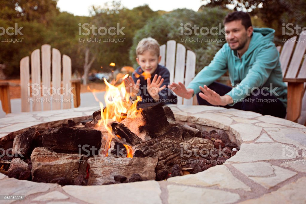 family by firepit stock photo